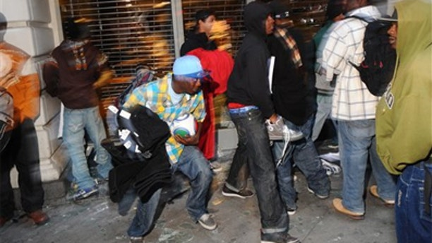 July 8: Looters are seen making off with merchandise outside of a Foot Locker store in Oakland, Calif., following the verdict in a racially charged train station shooting case.