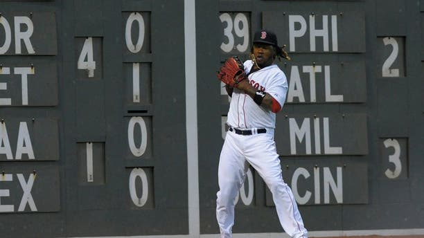 Jul 3, 2015; Boston, MA, USA; Boston Red Sox left fielder Hanley Ramirez (13) mishandles the ball during the fourth inning against the Houston Astros at Fenway Park. Mandatory Credit: Bob DeChiara-USA TODAY Sports