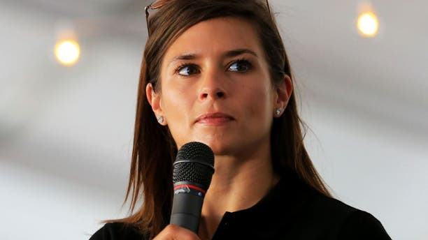 DOVER, DE - MAY 31: Danica Patrick, driver of the #10 GoDaddy Chevrolet, speaks ot fans prior to the NASCAR Sprint Cup Series FedEx 400 Benefiting Autism Speaks at Dover International Speedway on May 31, 2015 in Dover, Delaware. (Photo by Daniel Shirey/NASCAR via Getty Images)