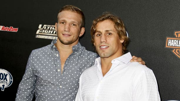 HOLLYWOOD, CA - SEPTEMBER 09: (L-R) TJ Dillashaw and Urijah Faber attend FOX Sports 1's 'The Ultimate Fighter' season premiere party at Lure on September 9, 2014 in Hollywood, California. (Photo by Tibrina Hobson/WireImage)