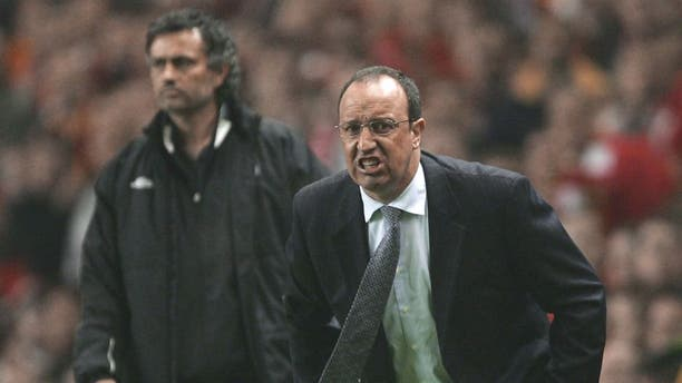 LIVERPOOL, ENGLAND - MAY 3: Jose Mourinho the manager of Chelsea and Rafael Benitez the manager of Liverpool shout instructions to their players during the Champions League semi final second leg match between Liverpool and Chelsea at Anfield on May 3, 2005 in Liverpool, England. (Photo by Alex Livesey/Getty Images)