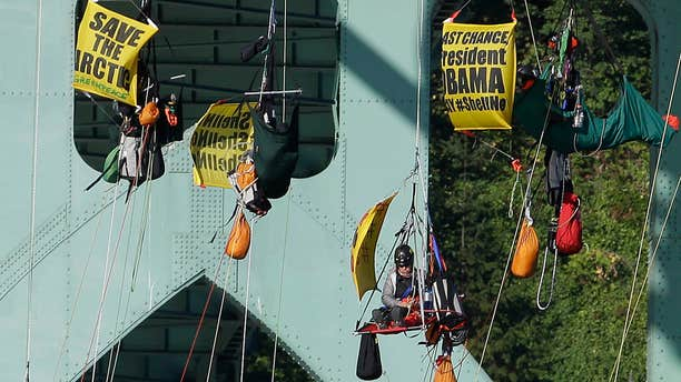 July 29, 2015: Activists hang from the St. Johns bridge in Portland, Ore. to protest the departure of Royal Dutch Shell PLC icebreaker Fennica, which is in Portland for repairs.