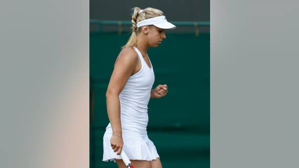 Sabine Lisicki of Germany celebrates a point during the women's singles match against Yaroslava Shvedova of Kazakhstan at the All England Lawn Tennis Championships in Wimbledon, London, Tuesday, July 1, 2014. (AP Photo/Sang Tan)