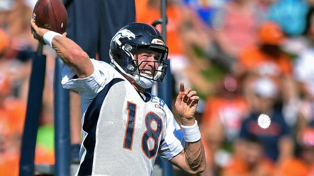 ENGLEWOOD, CO - AUGUST 02: Denver Broncos quarterback Peyton Manning (18) drops back to pass during drills at practice on day 3 of training camp August 2, 2015 at Dove Valley. (Photo By John Leyba/The Denver Post via Getty Images)