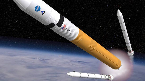 This artist's concept shows the Ares V cargo launch vehicle, a rocket that may be similar to NASA's Space Launch System (SLS) in many ways.