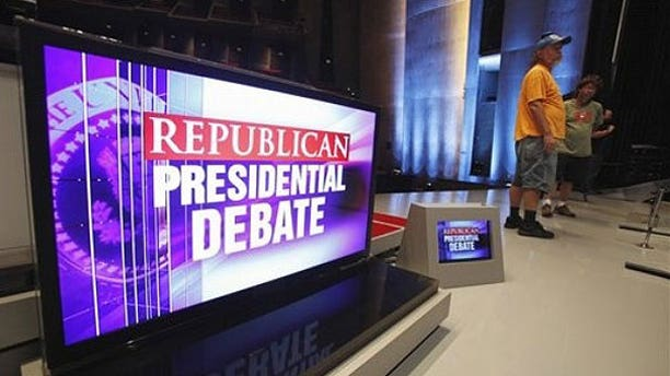 August 10: Workers are seen on stage at CY Stephens Auditorium in Ames, Iowa, during setup up for Thursday's Iowa GOP/Fox News Debate.