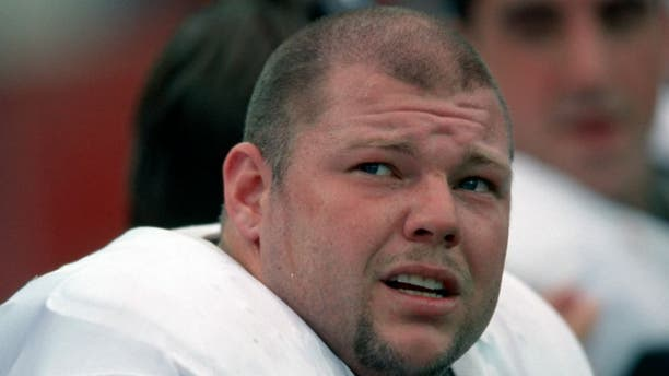 ORCHARD PARK, NY - OCTOBER 17: Offensive lineman Barret Robbins #63 of the Oakland Raiders on the bench during a game against the Buffalo Bills at Rich Stadium on October 17, 1999 in Orchard Park, New York. (Photo by George Gojkovich/Getty Images)