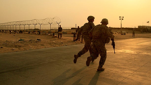 Aug. 18: U.S. Army soldiers from 2nd Battalion, 23rd Infantry Regiment, 4th Brigade, 2nd Infantry Division race toward the border from Iraq into Kuwait.