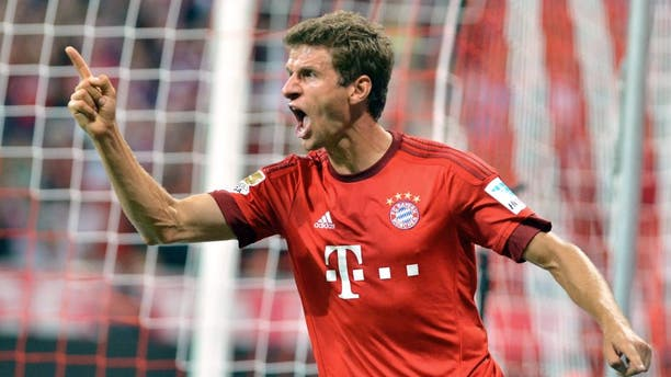 MUNICH, GERMANY - AUGUST 14: Thomas Mueller of Munich celebrates after scoring a goal during the German Bundesliga soccer match between Bayern Munich and Hamburger SV at the Allianz Arena in Munich, Germany on August 14, 2015. (Photo by Joerg Koch/Anadolu Agency/Getty Images)
