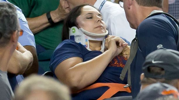 DETROIT, MI - AUGUST 21: A fan is carried out by medics after getting hit in the side of her head by a foul ball in the eighth inning during a MLB game between the Detroit Tigers and the Texas Rangers at Comerica Park on August 21, 2015 in Detroit, Michigan.(Photo by Dave Reginek/Getty Images)