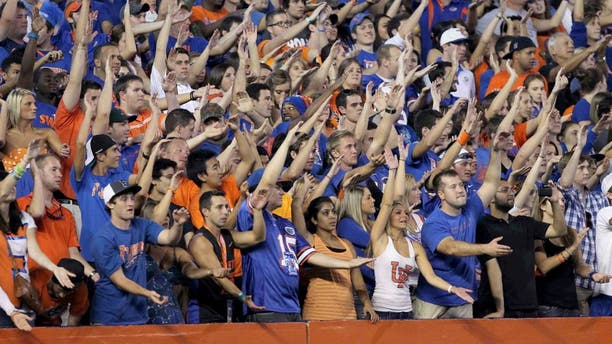 October 1, 2011; Gainesville FL, USA; Florida Gators fans do the gator chomp and cheer during the first quarter against the Alabama Crimson Tide at Ben Hill Griffin Stadium. Mandatory Credit: Kim Klement-USA TODAY Sports