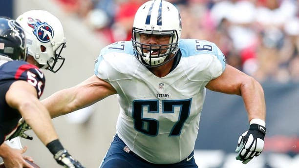 Nov 30, 2014; Houston, TX, USA; Tennessee Titans guard Andy Levitre (67) in action against the Houston Texans at NRG Stadium. Mandatory Credit: Matthew Emmons-USA TODAY Sports
