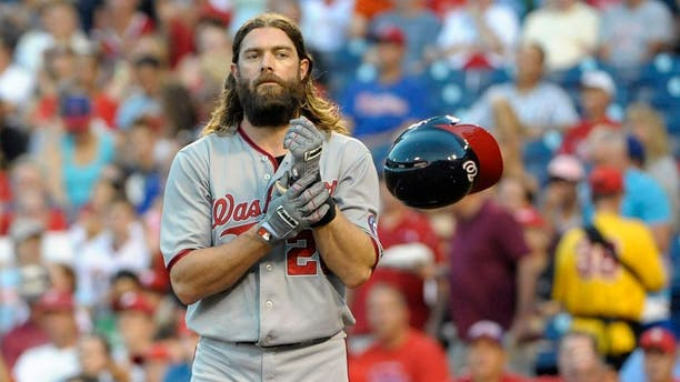 Aug 25, 2014; Philadelphia, PA, USA; Washington Nationals right fielder Jayson Werth (28) tosses his helmet after striking out to end the first inning against the Philadelphia Phillies at Citizens Bank Park. Mandatory Credit: Eric Hartline-USA TODAY Sports