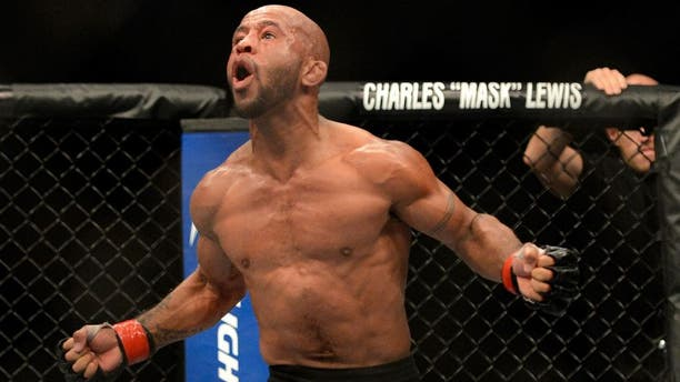 SEATTLE, WA - JULY 27: Demetrious Johnson celebrates his victory over John Moraga in their flyweight championship bout during the UFC on FOX event at Key Arena on July 27, 2013 in Seattle, Washington. (Photo by Jeff Bottari/Zuffa LLC/Zuffa LLC via Getty Images)