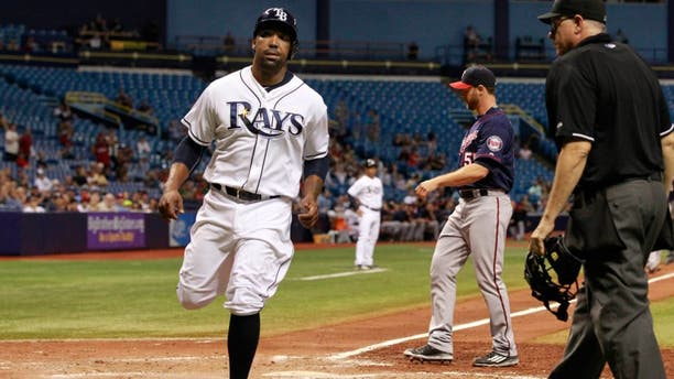 Aug 27, 2015; St. Petersburg, FL, USA; Tampa Bay Rays designated hitter Joey Butler (9) scores a run on a wild pitch by Minnesota Twins relief pitcher Neal Cotts (55) during the sixth inning at Tropicana Field. Mandatory Credit: Kim Klement-USA TODAY Sports