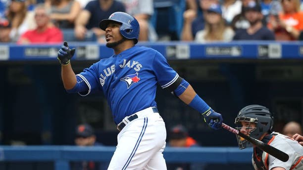TORONTO, CANADA - AUGUST 29: Edwin Encarnacion #10 of the Toronto Blue Jays hits a three-run home run in the first inning during MLB game action against the Detroit Tigers on August 29, 2015 at Rogers Centre in Toronto, Ontario, Canada. (Photo by Tom Szczerbowski/Getty Images)