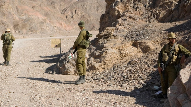 Aug. 19: Israeli soldiers secure the area near roads leading to the sites of several attacks in the Arava desert, near the southern Israeli resort town of Eilat.