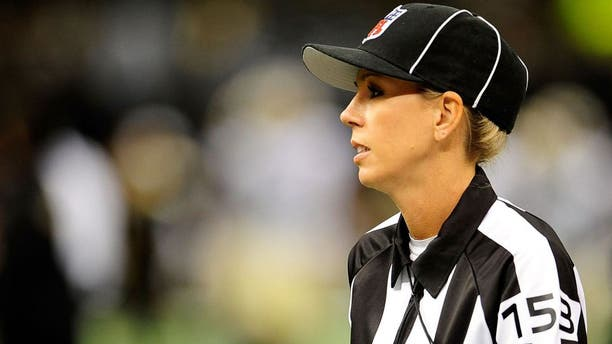 NEW ORLEANS, LA - AUGUST 16: Line judge Sarah Thomas, takes the field for a preseason game between the Oakland Raiders and the New Orleans Saints at the Mercedes-Benz Superdome on August 16, 2013 in New Orleans, Louisiana. The Saints won 28-20. (Photo by Stacy Revere/Getty Images)