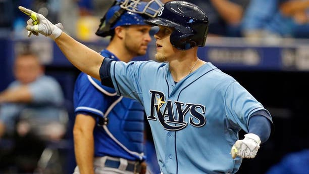 Tampa Bay Rays' Brandon Guyer celebrates as he crosses home plate in front of Kansas City Royals catcher Drew Butera after his home run during the third inning of a baseball game Sunday, Aug. 30, 2015, in St. Petersburg, Fla. (AP Photo/Mike Carlson)