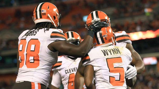 Aug 20, 2015; Cleveland, OH, USA; Cleveland Browns wide receiver Shane Wynn (5) celebrates with teammates after catching a pass for a touchdown during the fourth quarter of a preseason game against the Buffalo Bills at FirstEnergy Stadium. Mandatory Credit: Andrew Weber-USA TODAY Sports