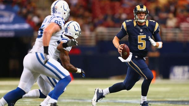 ST. LOUIS, MO - AUGUST 29: Nick Foles #5 of the St. Louis Rams looks to pass the ball against the Indianapolis Colts in the second quarter during a preseason game at the Edward Jones Dome on August 29, 2014 in St. Louis, Missouri. (Photo by Dilip Vishwanat/Getty Images)