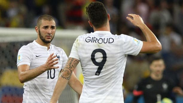 France's forward Olivier Giroud (R) and France's forward Karim Benzema shake hands after drawing 0-0 at the end of the Group E football match between Ecuador and France at the Maracana Stadium in Rio de Janeiro during the 2014 FIFA World Cup on June 25, 2014. AFP PHOTO / FRANCK FIFE (Photo credit should read FRANCK FIFE/AFP/Getty Images)