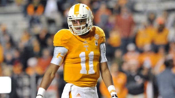 Nov 22, 2014; Knoxville, TN, USA; Tennessee Volunteers quarterback Joshua Dobbs (11) during warm ups prior to the game against the Missouri Tigers at Neyland Stadium. Mandatory Credit: Jim Brown-USA TODAY Sports