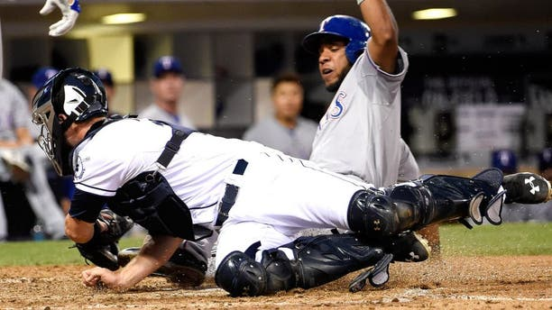 SAN DIEGO, CA - SEPTEMBER 1: Elvis Andrus #1 of the Texas Rangers steals home ahead of the tag of Austin Hedges #18 of the San Diego Padres during the seventh inning of a baseball game at Petco Park September, 1, 2015 in San Diego, California. (Photo by Denis Poroy/Getty Images)