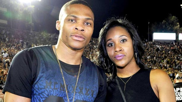 """PASADENA, CA - AUGUST 02: (L-R) Russell Westbrook and Nina Earl attend D'USSE VIP riser and lounge at """"On The Run Tour"""" at Rose Bowl on August 2, 2014 in Pasadena, California. (Photo by John Sciulli/Getty Images for D'USSE)"""