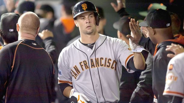 DENVER, CO - SEPTEMBER 3: Ryan Vogelsong #32 of the San Francisco Giants in the dugout after hitting his first career home run in the fourth inning of a game at Coors Field on September 3, 2015 in Denver, Colorado. (Photo by Dustin Bradford/Getty Images)