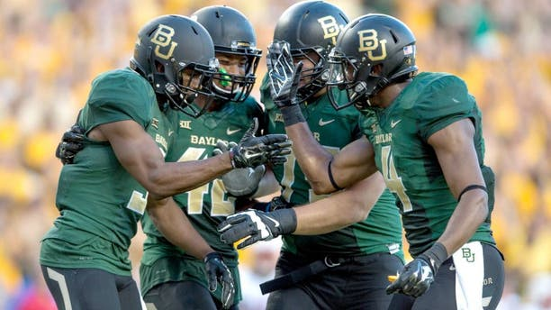Aug 31, 2014; Waco, TX, USA; Baylor Bears wide receiver KD Cannon (9) and running back Levi Norwood (42) and wide receiver Jay Lee (4) celebrate Cannons touchdown against the Southern Methodist Mustangs during the first half at McLane Stadium. Mandatory Credit: Jerome Miron-USA TODAY Sports