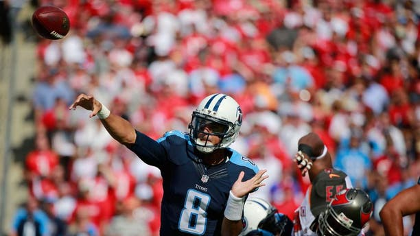 Sep 13, 2015; Tampa, FL, USA; Tennessee Titans quarterback Marcus Mariota (8) throws the ball against the Tampa Bay Buccaneers during the first quarter at Raymond James Stadium. Mandatory Credit: Kim Klement-USA TODAY Sports