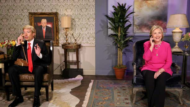 """In this image released by NBC, host Jimmy Fallon, portraying Donald Trump, left, and Hillary Rodham Clinton appear during a skit titled, """"Trump calls Hillary"""" during a taping of """"The Tonight Show Starring Jimmy Fallon,"""" on Wednesday, Sept. 16, 2015, in New York."""