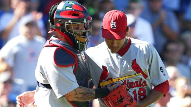 CHICAGO, IL - SEPTEMBER 20: Carlos Martinez #18 of the St. Louis Cardinals talks with catcher Yadier Molina #4 of the St. Louis Cardinals during the third inning at Wrigley Field on September 20, 2015 in Chicago, Illinois. The Cardinals defeated the Cubs 4-3. (Photo by John Konstantaras/Getty Images)