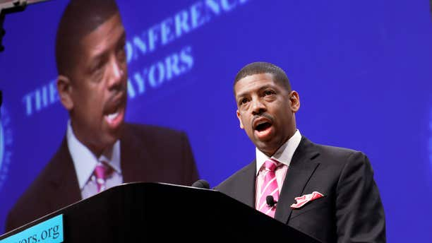 FILE -In this June 23, 2014 file photo, Sacramento, Calif., Mayor Kevin Johnson, president of the U.S. Conference of Mayors, speaks before a panel discussion about sports and race relations during a conference meeting in Dallas.