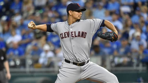 Cleveland Indians pitcher Carlos Carrasco delivers a pitch against the Kansas City Royals during the first inning at Kauffman Stadium.