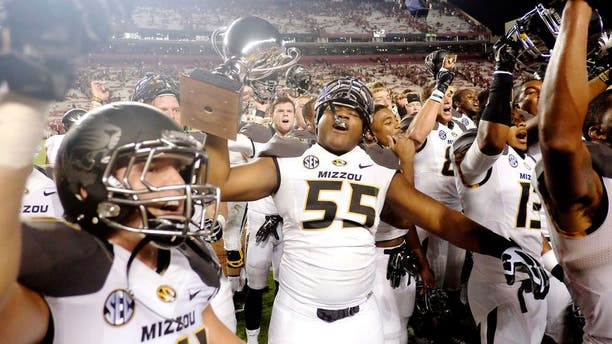 COLUMBIA, SC - SEPTEMBER 27: Offensive Lineman Nate Crawford #55 of the Missouri Tigers hoists the Mayor's Cup after the game against the South Carolina Gamecocks on September 27, 2014 at Williams-Brice Stadium in Columbia, South Carolina. Missouri won 21-20. (Photo by Todd Bennett/GettyImages)