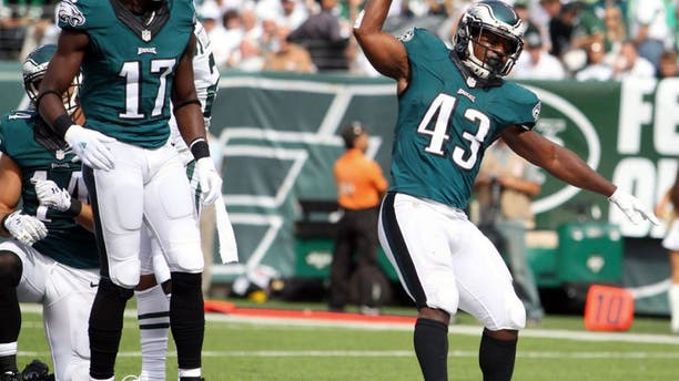 Sep 27, 2015; East Rutherford, NJ, USA; Philadelphia Eagles running back Darren Sproles (43) celebrates a touchdown against the New York Jets during the second quarter at MetLife Stadium. Mandatory Credit: Brad Penner-USA TODAY Sports