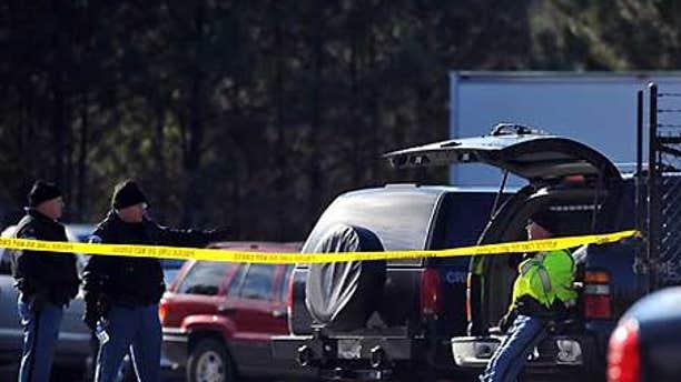 Jan. 12: Police gather after a shooting at Penske Rental in Kennesaw, Ga.