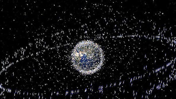 More than 20,000 pieces of space junk are orbiting planet Earth, putting our communications satellites in serious danger.