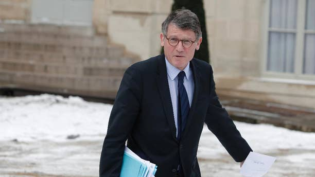 FILE - In this March 13, 2013 file photo, then French Education Minister Vincent Peillon leaves the Elysee Palace after the weekly cabinet meeting, in Paris. Candidates in the leftist primary Jan 22 and 29 Manuel Valls and Vincent Peillon laid out their platforms Tuesday Jan. 3, 2017, pleading for unity and tolerance in the face of far right candidate Marine Le Pen's anti-immigration, anti-EU campaign.(AP Photo/Thibault Camus, File)