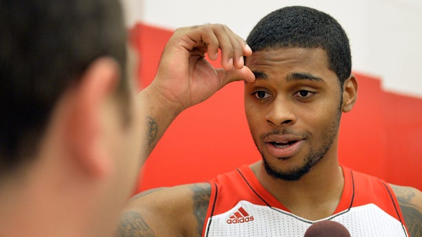 Louisville's Chane Behanan fields questions during NCAA college basketball media day, Saturday, Oct. 12, 2013, in Louisville, Ky. (AP Photo/Timothy D. Easley)