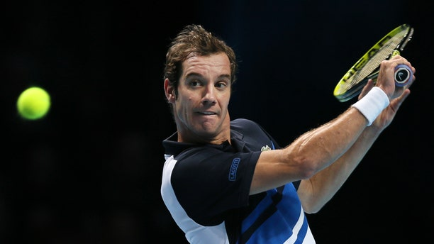 Richard Gasquet of France plays a return to Novak Djokovic of Serbia during their ATP World Tour Finals tennis match at the O2 Arena in London, Saturday, Nov. 9, 2013. (AP Photo/Alastair Grant)