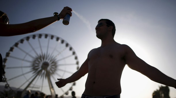 FILE: A man is sprayed with sunscreen in Indioo, Calif.