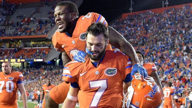 Florida running back Kelvin Taylor celebrates by jumping on quarterback Will Grier (7) after their 38-10 win over Mississippi in an NCAA college football game Saturday, Oct. 3, 2015, in Gainesville, Fla. (AP Photo/Phelan M. Ebenhack)