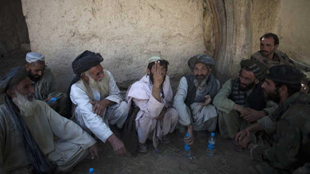 Oct. 6: Local residents meet with Afghan and U.S. soldiers to discuss security at an outpost near Forward Operation Base Howz-e-Madad, Zhari district, Kandahar province, Afghanistan.