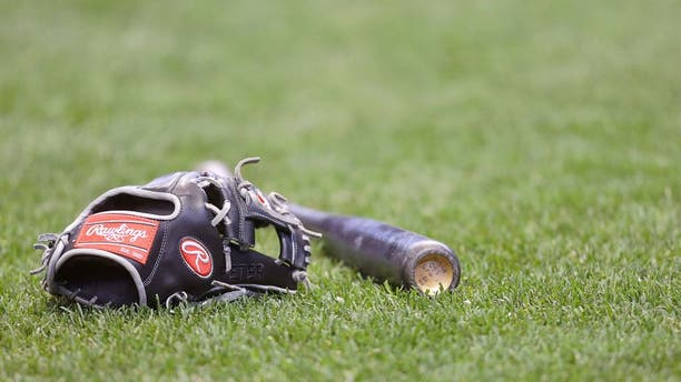 MILWAUKEE, WI - APRIL 25: A St. Louis Cardinals Rawling glove and bat on the grass before the game against the Milwaukee Brewers at Miller Park on April 25, 2015 in Milwaukee, Wisconsin. (Photo by Mike McGinnis/Getty Images)