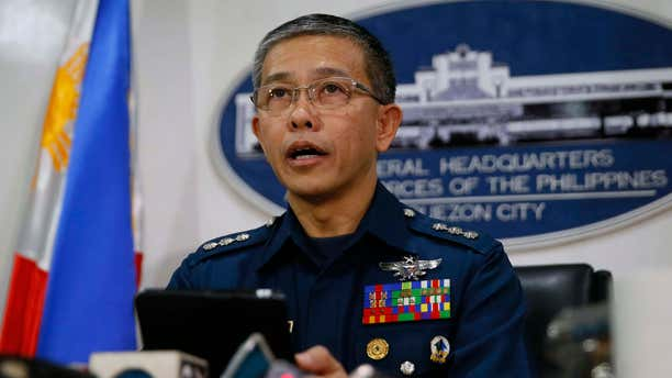 Oct. 14, 2015: Col. Restituto Padilla, spokesman of the Armed Forces of the Philippines, reads the military's reaction to the video purportedly showing for the first time two Canadians, a Norwegian and a Filipino woman who were abducted last month from a southern Philippines resort, demanding that government forces stop artillery fire and assaults, following a news conference.