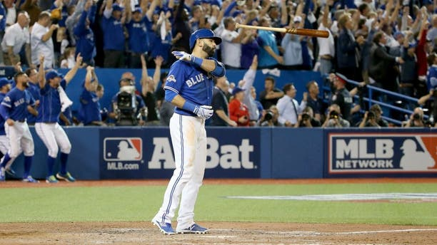 TORONTO, ON - OCTOBER 14: Jose Bautista #19 of the Toronto Blue Jays flips his bat up in the air after he hits a three-run home run in the seventh inning against the Texas Rangers in game five of the American League Division Series at Rogers Centre on October 14, 2015 in Toronto, Canada. (Photo by Tom Szczerbowski/Getty Images)