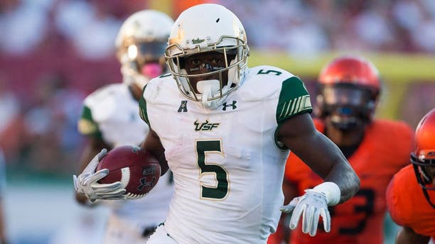 Oct 10, 2015; Tampa, FL, USA; South Florida Bulls running back Marlon Mack (5) runs for a touchdown in the third quarter against the Syracuse Orange at Raymond James Stadium. The South Florida Bulls won 45-24. Mandatory Credit: Logan Bowles-USA TODAY Sports